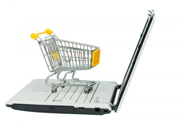 http://www.dreamstime.com/stock-photos-shopping-cart-empty-laptop-computer-symbolic-photo-internet-image36385623