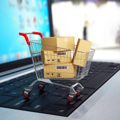 http://www.dreamstime.com/royalty-free-stock-photography-e-commerce-shopping-cart-cardboard-boxes-laptop-d-image40383607